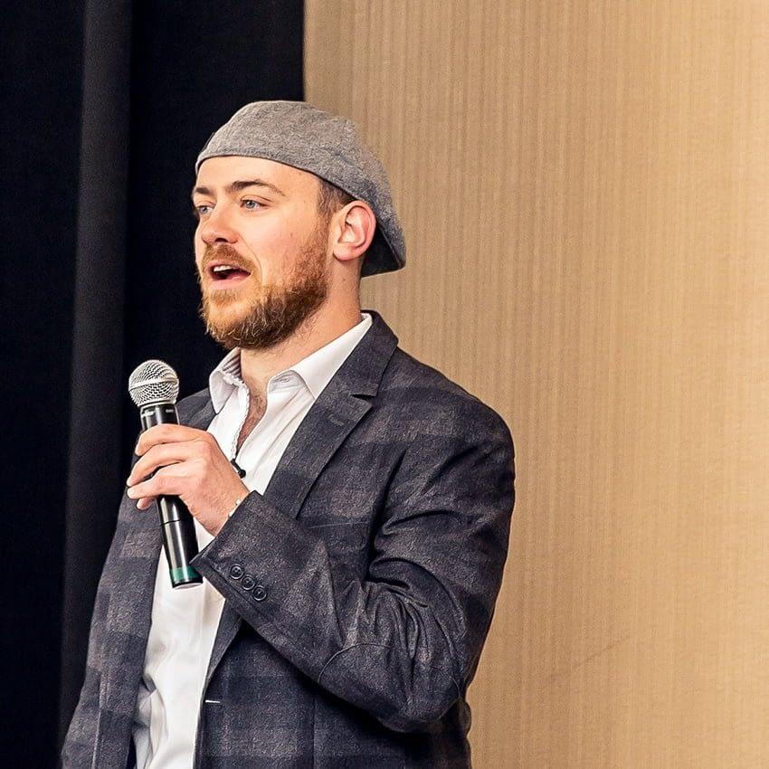 Ari Gunzburg giving keynote speech